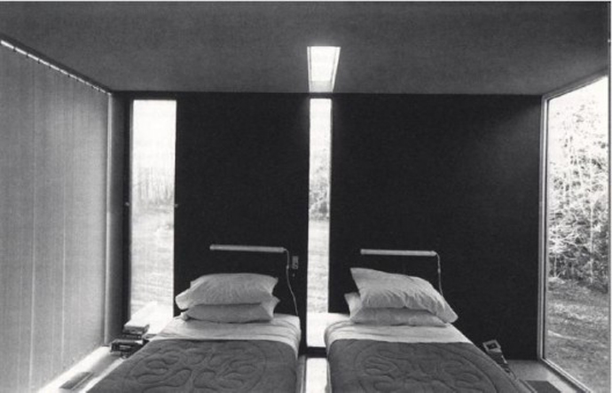 Image of a Peter Eisenman-designed house with glass slot in the center of the wall continuing through the floor that divides the room in half, forcing there to be separate beds on either side of the room so that the couple was forced to sleep apart from each other. ArchDaily