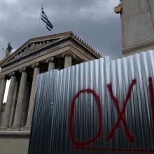 The word OXI (No) is written on a wall in front of the Greek Academy in Athens, Greece. Photograph: Simela Pantzartzi/EPA